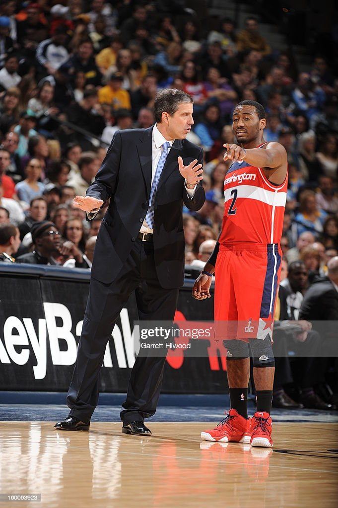Randy Wittman and John Wall #2 of the Washington Wizards during the game against the Denver Nuggets on January 18, 2013 at the Pepsi Center in Denver, Colorado.