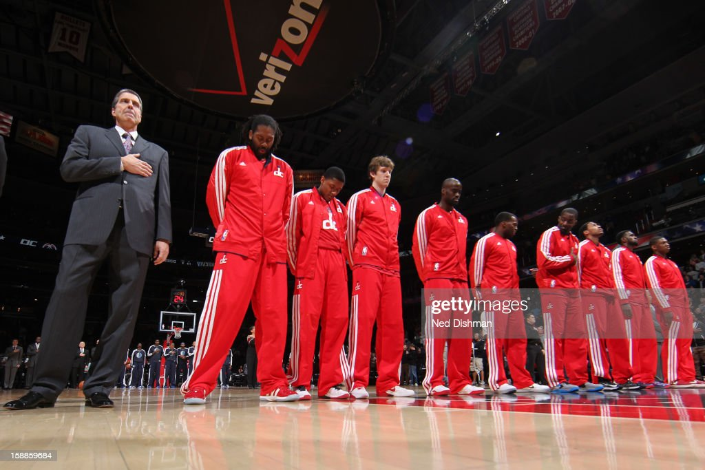 Randy Wittman Head Coach of the Washington Wizards stands during the national anthem against the Dallas Mavericks during the game at the Verizon Center on January 1, 2013 in Washington, DC.