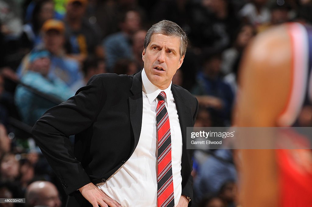 Randy Wittman head coach of the Washington Wizards stands on the court during a game against the Denver Nuggets on March 23 2014 at the Pepsi Center...