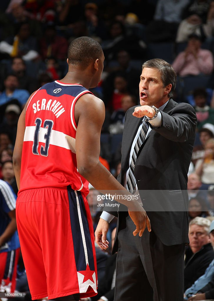 Randy Wittman, head coach, talks with Kevin Seraphin #13 of the Washington Wizards in a game against the Memphis Grizzlies on February 1, 2013 at FedExForum in Memphis, Tennessee.