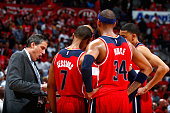 Randy Wittman of the Washington Wizards huddles his players during a timeout against the Atlanta Hawks in Game Two of the Eastern Conference...