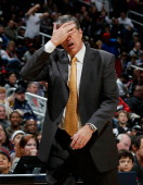 Randy Wittman of the Washington Wizards reacts to the referees during the game against the Atlanta Hawks at Philips Arena on December 13 2013 in...