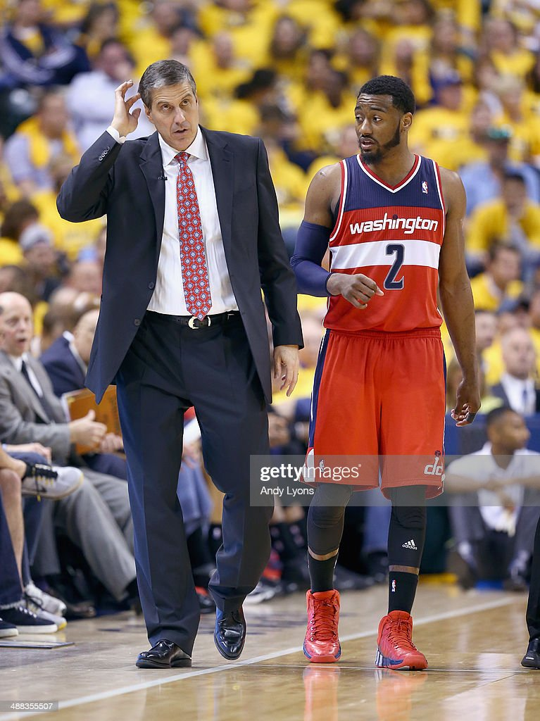 Randy Wittman the coach of the Washington Wizards gives instructions to John Wall against the Indiana Pacers in Game 1 of the Eastern Conference...
