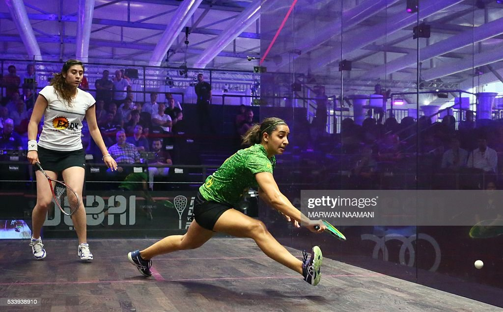 Raneem al-Welily of Egypt (L) plays a backhand against her compatriot Nour el-Sherbini during their match of the Dubai PSA World Series Finals squash tournament in Dubai, on May 24, 2016. / AFP / MARWAN