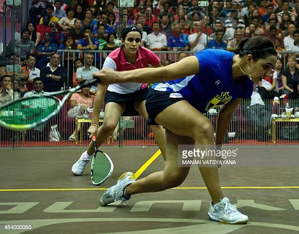 Raneem El Weleily of Egypt returns a shot against compatriot Nour El Tayeb during the 2014 CIMB Malaysian Open Squash Women's final match in Kuala...