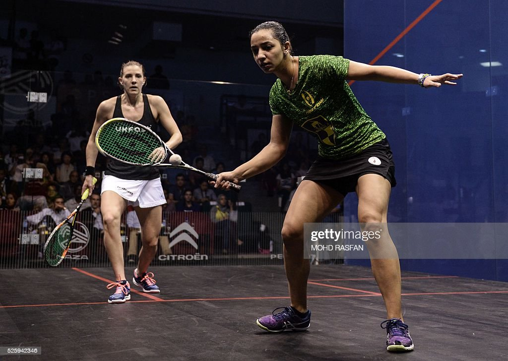 Raneem El Welily of Egypt (R) plays a forehand against Laura Massaro of England (L) during their semi-final match of the PSA Women's World Championships squash tournament in Bukit Jalil, oustide Kuala Lumpur on April 29, 2016. / AFP / MOHD