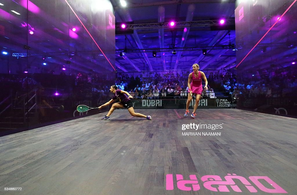 Raneem el-Welily of Egypt (L) plays a forehand to Laura Massaro of Great Britian in the final match of the Dubai PSA World Series Finals squash tournament in Dubai, May 28, 2016. / AFP / MARWAN