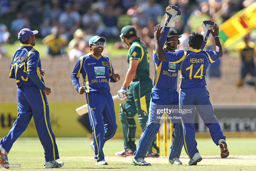 <a gi-track='captionPersonalityLinkClicked' href=/galleries/search?phrase=Rangana+Herath&family=editorial&specificpeople=2303669 ng-click='$event.stopPropagation()'>Rangana Herath</a> celebrates with team mates after bowling out Peter Forrest of Australia during the third One Day International Final series match between Australia and Sri Lanka at Adelaide Oval on March 8, 2012 in Adelaide, Australia.