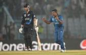 Rangana Herath of Sri Lanka celebrates dismissing Jimmy Neesham of New Zealand during the ICC World Twenty20 Bangladesh 2014 Group 1 match between...