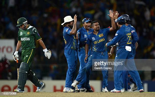 Rangana Herath of Sri Lanka celebrates with teammates after bowling Shahid Afridi of Pakistan during the ICC World Twenty20 2012 Semi Final between...