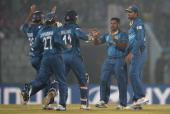 Rangana Herath of Sri Lanka celebrates with teammates after dismissing Brendon McCullum of New Zealand during the ICC World Twenty20 Bangladesh 2014...