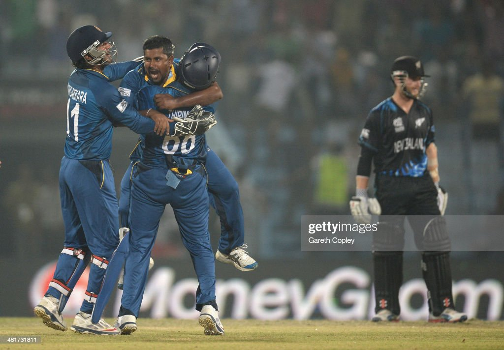 <a gi-track='captionPersonalityLinkClicked' href=/galleries/search?phrase=Rangana+Herath&family=editorial&specificpeople=2303669 ng-click='$event.stopPropagation()'>Rangana Herath</a> of Sri Lanka celebrates with teammates after dismissing Jimmy Neesham of New Zealand during the ICC World Twenty20 Bangladesh 2014 Group 1 match between Sri Lanka and New Zealand at Zahur Ahmed Chowdhury Stadium on March 31, 2014 in Chittagong, Bangladesh.