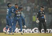 Rangana Herath of Sri Lanka celebrates with teammates after dismissing Jimmy Neesham of New Zealand during the ICC World Twenty20 Bangladesh 2014...