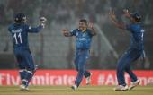 Rangana Herath of Sri Lanka celebrates with teammates after dismissing Trent Boult of New Zealand during the ICC World Twenty20 Bangladesh 2014 Group...