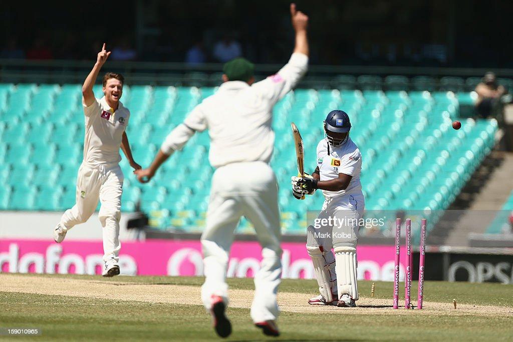 Rangana Herath of Sri Lanka is bowled by Jackson Bird of Australia during day four of the Third Test match between Australia and Sri Lanka at Sydney Cricket Ground on January 6, 2013 in Sydney, Australia.