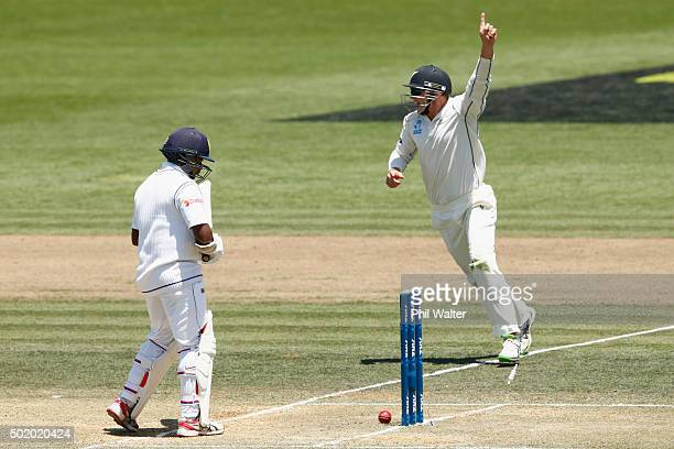 Rangana Herath of Sri Lanka is bowled by Tim Southee as Tom Latham celebrates during day three of the Second Test match between New Zealand and Sri...
