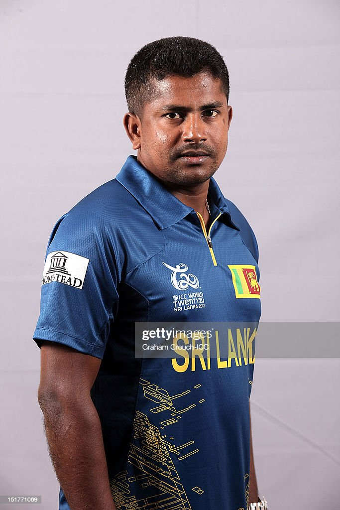 <a gi-track='captionPersonalityLinkClicked' href=/galleries/search?phrase=Rangana+Herath&family=editorial&specificpeople=2303669 ng-click='$event.stopPropagation()'>Rangana Herath</a> of Sri Lanka poses on September 11, 2012 in Colombo, Sri Lanka.