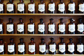 A range of natural spirits, acids and oils in homeopathic pharmacy