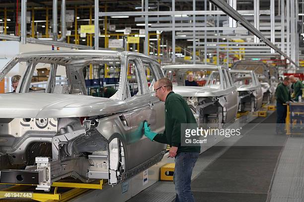 Range Rovers and Land Rovers are built on the production line at the Jaguar Land Rover factory on January 10 2014 in Solihull England The luxury...