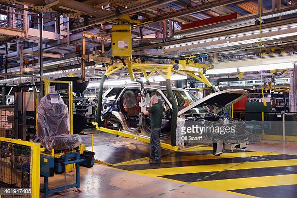 Range Rovers and Land Rovers are built on the production line of the Jaguar Land Rover factory on January 10 2014 in Solihull England The luxury...