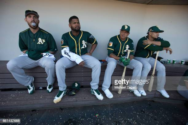 Rangel Ravelo Raul Alcantara Yairo Munoz and Franklin Barreto of the Oakland Athletics sit in the dugout during a game against the Chicago Cubs at...