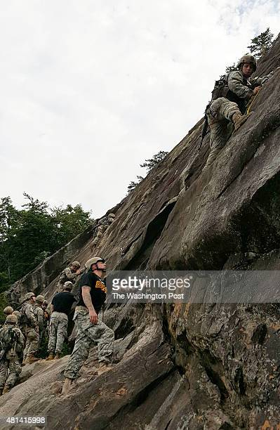 Ranger instructor offers guidance to the first ever woman to attempt an assault climb on Mount Yonah in Georgia as part of the Mountain Phase of...