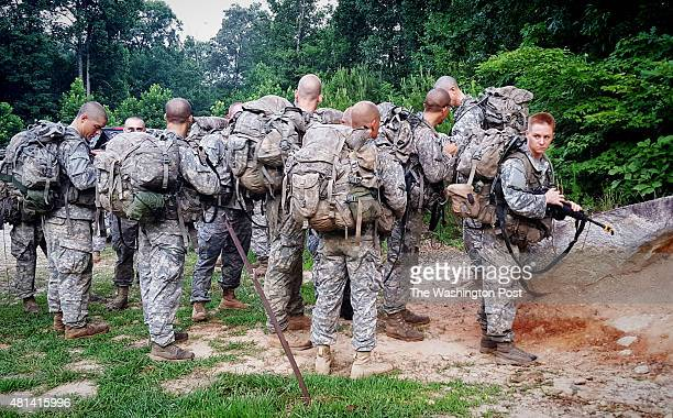 Ranger students including one of the first women ever to take the Ranger School course wait to ascend Mount Yonah in northern Georgias on Tuesday...
