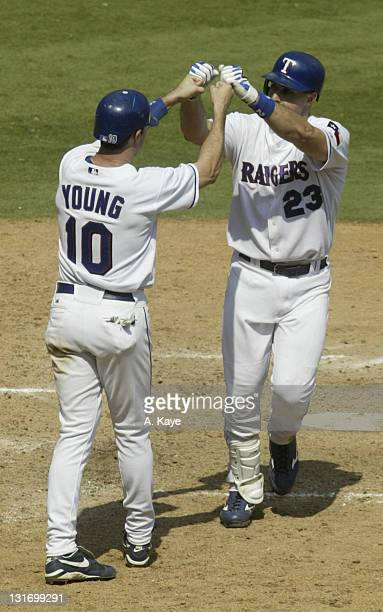 Rangers 1st Baseman Mark Tiexiera high five's Michael Young after driving him in with his game winning home run Texas Rangers sweep the Toronto Blue...