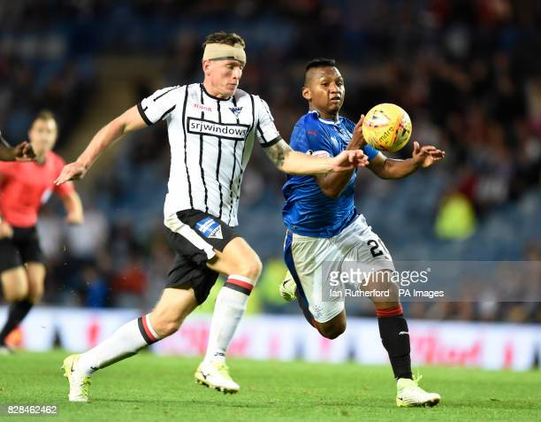 Rangers Alfredo Morelos tries to get past Dunfermilnes Lee Ashcroft during the Betfred Cup Second Round match at Ibrox Stadium Glasgow