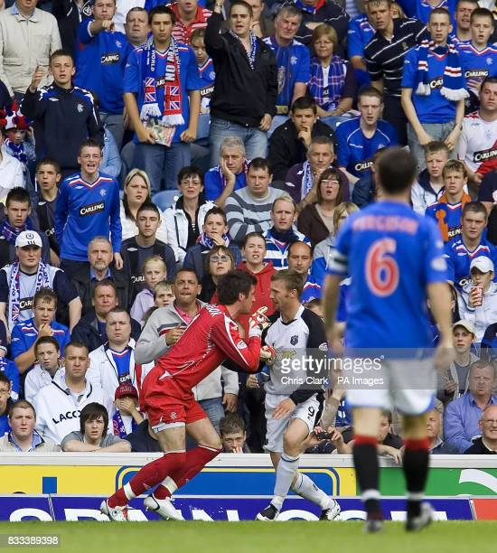 Rangers' Allan McGregor confronts Gretna's Colin McMenamin during the Clydesdale Bank Premier League match at Ibrox Stadium Glasgow