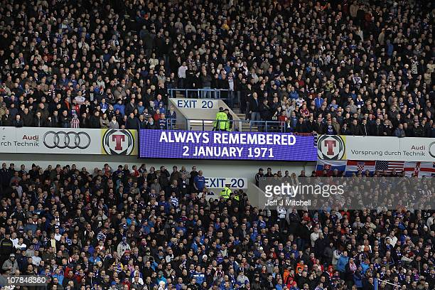 Rangers and Celtic fans observe a one minutes silence to mark 40th anniversary of the Ibrox disaster prior to their Clydesdale Bank Premier League...