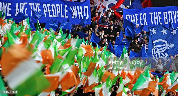 Rangers and Celtic fans wave flags before the start of the Scottish Premier League match between Rangers and Celtic at Ibrox stadium on May 9 2009 in...