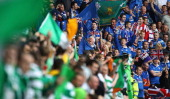 Rangers and Celtic supporters chant before the Clydesdale Bank Premier League match between Rangers and Celtic at Ibrox Stadium on April 24 2011 in...