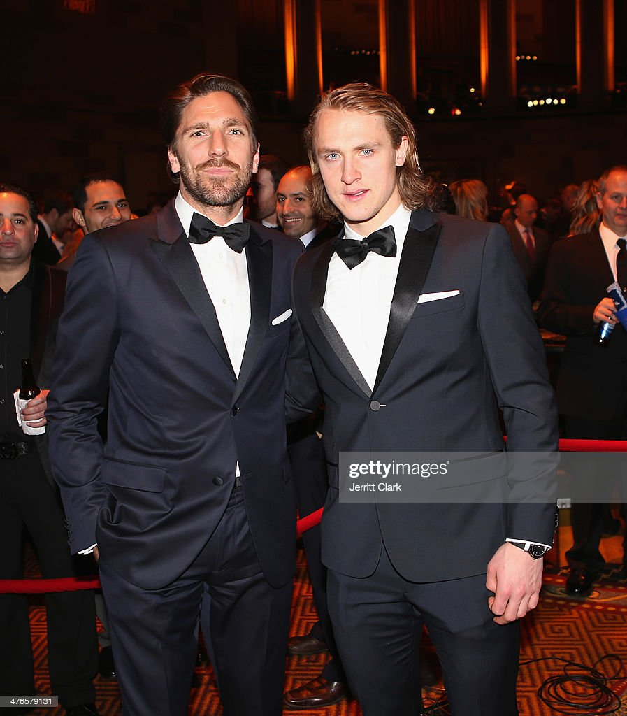 Rangers and Team Sweden hockey teammates Henrik Lundqvist and Carl Hagelin attends the 2014 New York Rangers Casino Night To Benefit The Garden Of...
