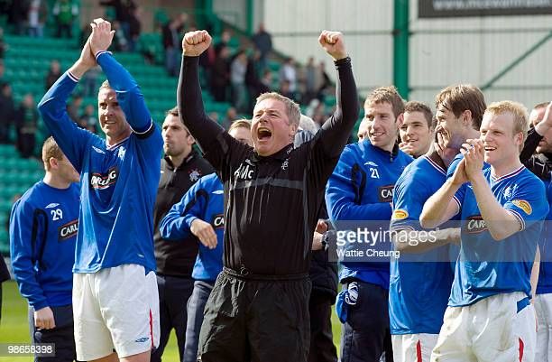 Rangers assistant Ally McCoist celebrates with the team winning the league after the Clydesdale Bank Scottish Premier League match between Hibernian...