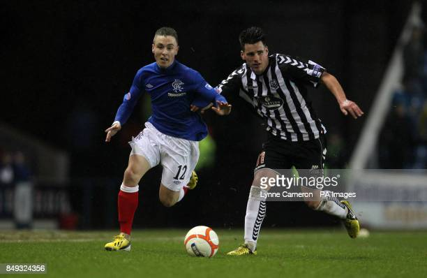 Ranger's Barrie McKay and Elgin City's Daniel Moore battle for the ball during the Irn Bru Scottish Third Division match at Ibrox Stadium Glasgow