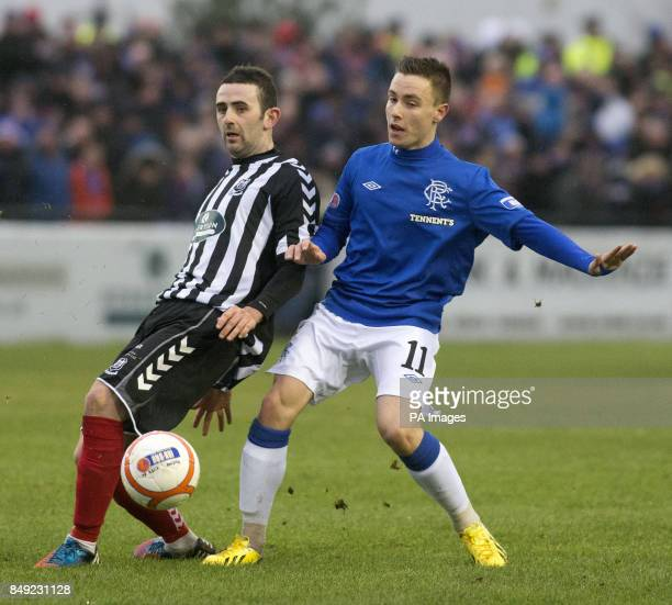 Rangers' Barrie McKay and Elgin's Paul Harkins during the Irn Bru Scottish Third Division match at Borough Briggs Elgin