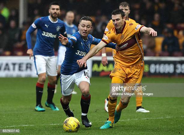 Rangers' Barrie McKay and Motherwell's Stephen McManus battle for the ball during the Ladbrokes Scottish Premiership match at Fir Par Motherwell