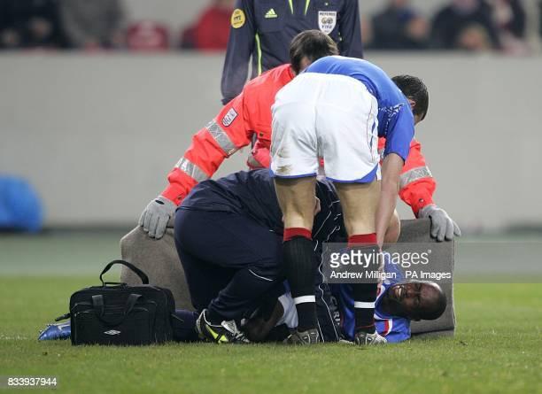 Rangers' Barry Ferguson attends to teammate DaMarcus Beasley after he is injured in a collision with VfB Stuttgart goalkeeper Raphael Schafer