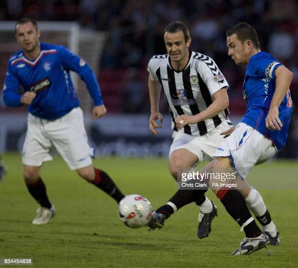 Rangers' Barry Ferguson passes the ball through to JeanClaude Darcheville for the third goal against St Mirren during the Clydesdale Bank Premier...