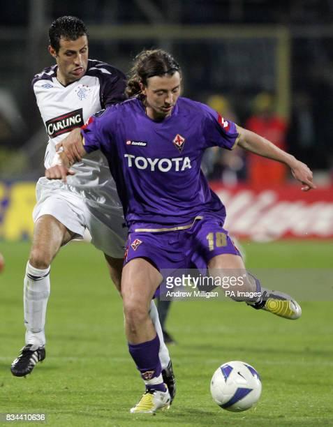 Rangers' Brahim Hemdani and Fiorentina's Riccardo Montolivo battle for the ball
