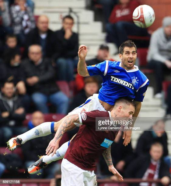 Ranger's Carlos Bocanegra and Heart's Ryan Stevenson battle for the ball in the air during the Clydesdale Bank Scottish Premier League match at...