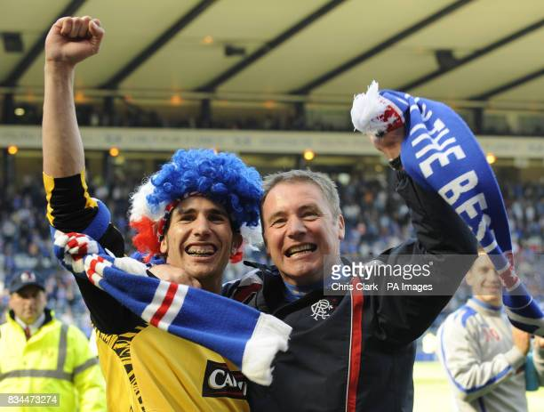 Rangers' Carlos Cuellar and assistant manager Ally McCoist celebrate after winning the Scottish Cup Final at Hampden Park Glasgow