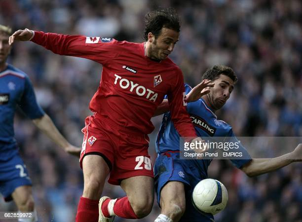 Rangers' Carlos Cuellar and Fiorentina's Giampaolo Pazzini battle for the ball
