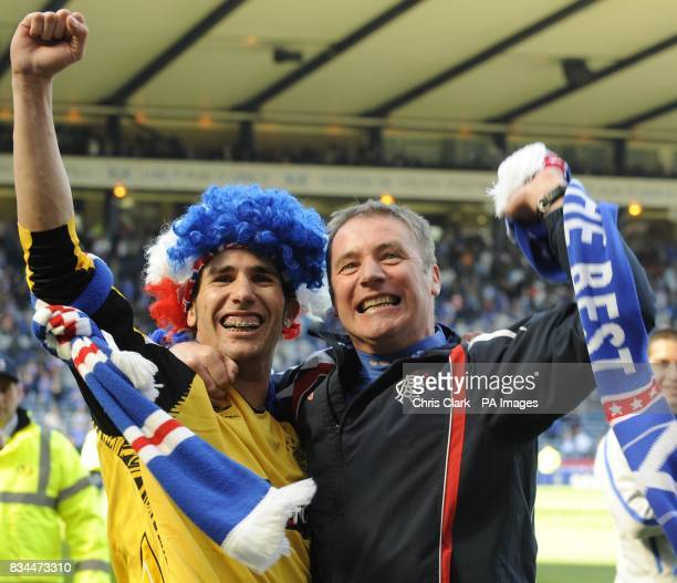 Rangers' Carlos Cuellar and Rangers assistant manager Ally McCoist celebrate after winning the Scottish Cup Final at Hampden Park Glasgow