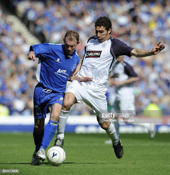 Rangers' Carlos Cuellar battles with Queen of the South's Steve Tosh during the Scottish Cup Final at Hampden Park Glasgow