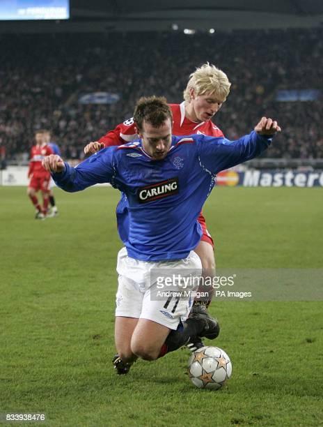 Rangers' Charlie Adam and VfB Stuttgart's Andreas Beck battle for the ball