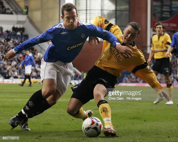 Rangers' Charlie Adam holds off the challenge from Falkirk's Thomas Scobie during the Bank of Scotland Premier League match at Ibrox Glasgow