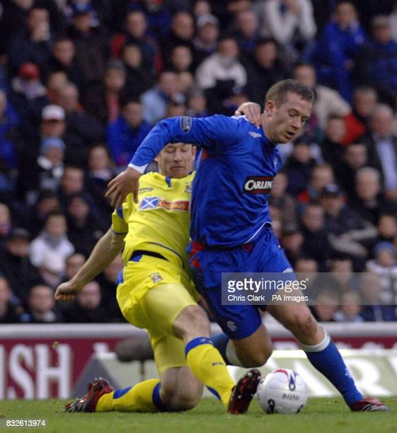 Rangers' Charlie Adam is tackled by Kilmarnock Fraser Wright during the Bank of Scotland Premier League match at Ibrox Stadium Glasgow