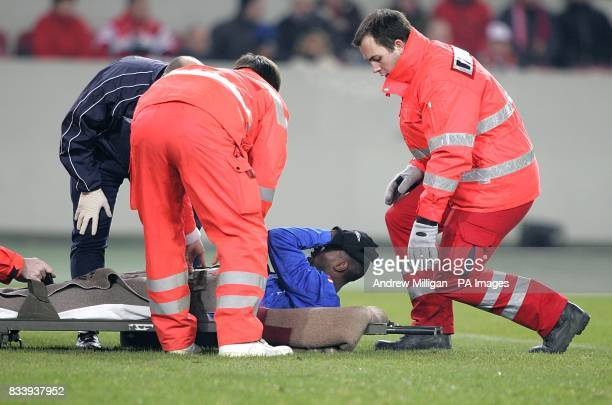 Rangers' DaMarcus Beasley is carried off the field on a stretcher after he is injured in a collision with VfB Stuttgart goalkeeper Raphael Schafer